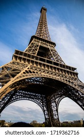 Eifel Tower in Paris, France at day and night