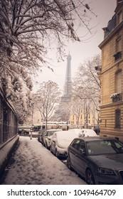 Eifel tower in snow in Paris, France. Rare Snow in Paris - the city of love.