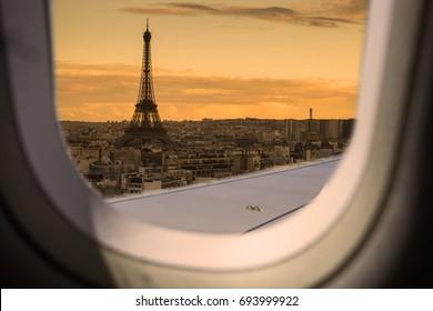 Eiffel as seen through window of an aircraft.