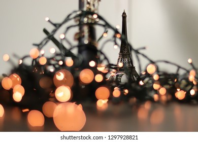 Eiffel Tour figure with the bokeh of an oboe (musical instrument)