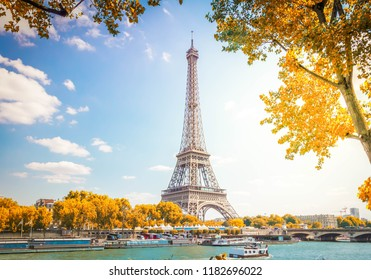 eiffel tour over Seine river with autumn tree, Paris, France