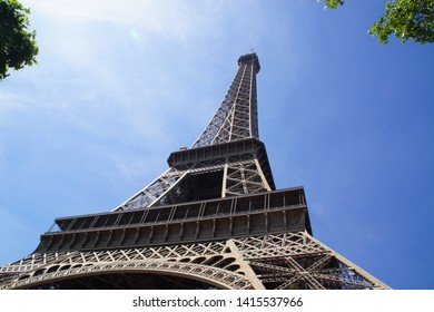 The Eiffel Tower is a 324 meter high puddled iron tower located in Paris, at the northwestern end of the park of Champ-de-Mars on the edge of the Seine in the 7 th arrondissement.