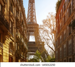 Eiffel tower between buildings in the last rays of the sun. Paris.France.