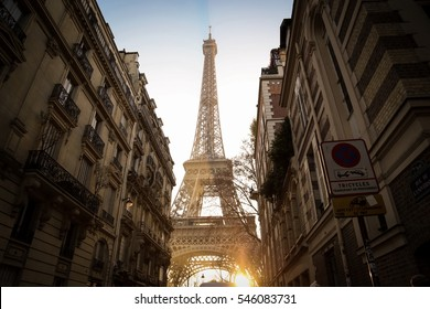 Eiffel tower between Parisian tenement