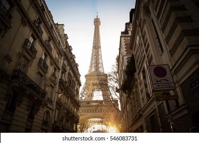 Eiffel tower between Parisian tenement