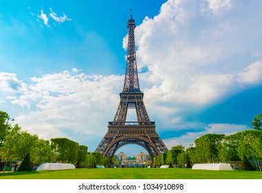 The Eiffel Tower with blue cloudy sky. Paris, France.