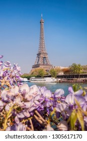 Eiffel Tower with boats during spring time in Paris, France