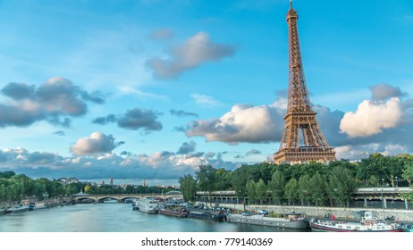Eiffel Tower with boats in evening timelapse Paris, France. View from Bir-Hakeim bridge before sunset. Blue cloudy sky at summer day
