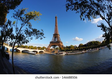 Eiffel Tower with boats on Seine in Paris, France