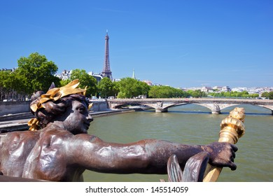 Eiffel Tower and bridge on Seine river in Paris, France. Artistic statue on Alexandre Bridge