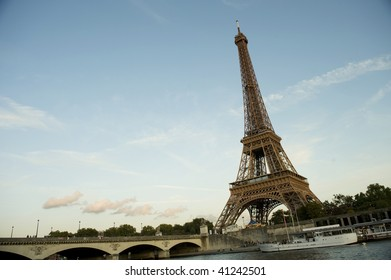 Eiffel tower with bridge Seine river and boats