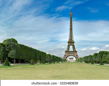 Eiffel Tower from Champ de Mars, Paris, France. Beautiful Romantic background, no people
