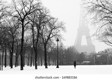 Eiffel tower and champ de Mars in snow, Paris, France