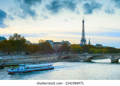 Eiffel Tower and cruise boat on Sienne river. Paris, france