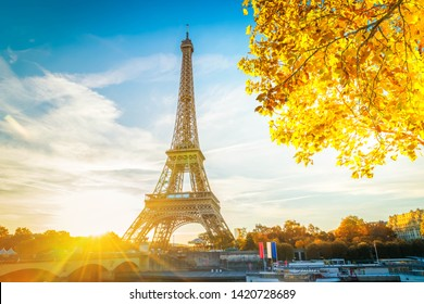 Eiffel Tower famous landmark with shining sun at sunrise, Paris, France at fall