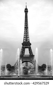 Eiffel tower with fountain, Paris. Black and white image