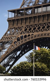 Eiffel Tower and french flag in Paris, France