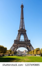 Eiffel Tower from the front. Great historical building in the center of Paris. Touristic center. French attraction