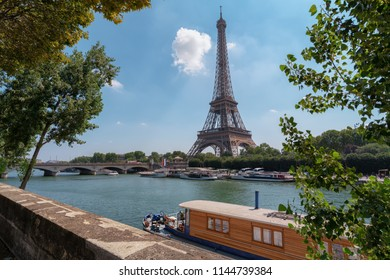 Eiffel Tower with house boat in front
