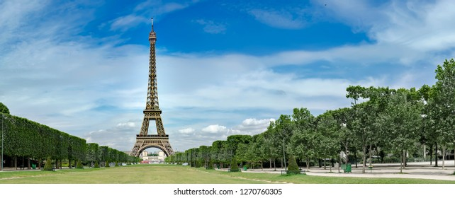 Eiffel Tower, iconic Paris landmark with vibrant blue sky, no people commercial background, panoramic view