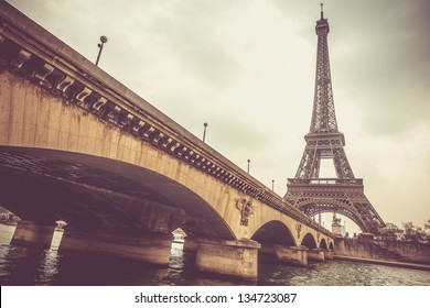 Eiffel tower and Jena bridge in a cloudy day
