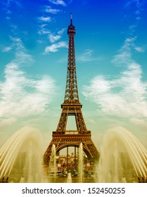 Eiffel Tower (La Tour Eiffel) with fountains over cloudy blue sky. Champ de Mars, Trocadero, Paris, Europe. Beautiful sunset landscape