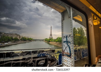 The Eiffel tower looked through the train's window while moving with dark sky background, Paris