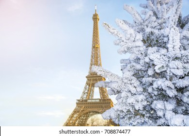 Eiffel Tower is the main attraction of Paris on the background of decorated Christmas trees in December. Travel Greeting Card with Christmas in Paris, France