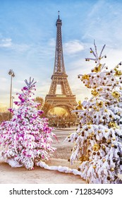 Eiffel Tower is the main attraction of Paris on the background of  frosty Christmas trees covered by snow in winter. Travel Greeting Card from Paris with love, France