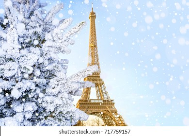 Eiffel Tower is the main attraction of Paris on the background of decorated Christmas trees in December. Travel Greeting Card.