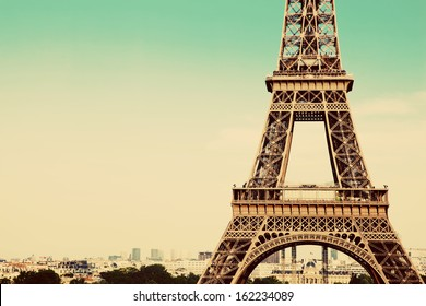 Eiffel Tower middle section, the city in the background, Paris, France. Vintage, retro style