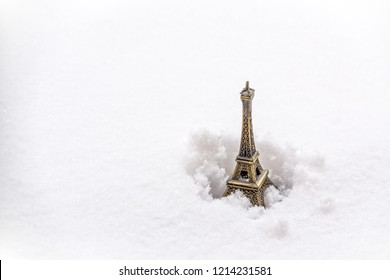 Eiffel tower miniature in the snow. Winter snowfall in Paris concept