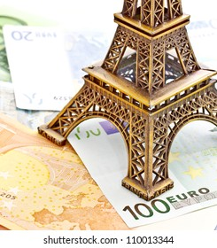 Eiffel tower model placed on Euro banknotes