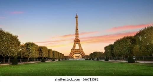 Eiffel Tower on Champs de Mars in Paris, France - Shutterstock ID 566715592