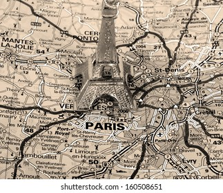 Eiffel Tower on a map of Paris, short focus,  black and white version.