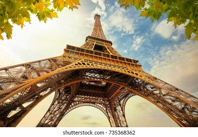 Eiffel Tower in Paris France. Eifel Tower with Golden Light Rays and Beautiful Architecture.