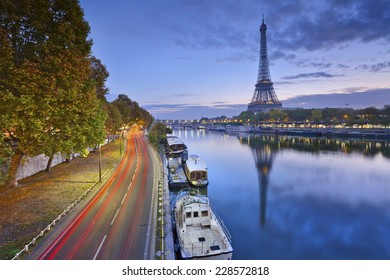Eiffel tower in Paris, France. Image of Eiffel tower with the reflection in the Seine river.