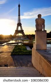 Eiffel tower. Paris. France. Statue and sunrise.