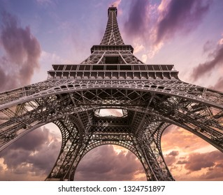 Eiffel Tower in Paris, France. From under against Beautiful Sunset Sky at Day Summer Time.