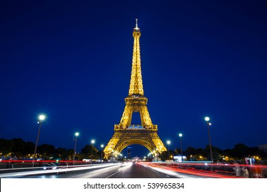 Eiffel Tower in Paris at night with lights on