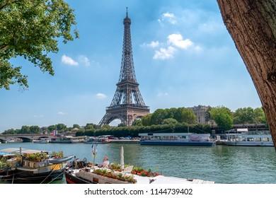 Eiffel Tower in Paris at the river Seine