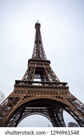 The Eiffel Tower in Paris shot against the sky.
