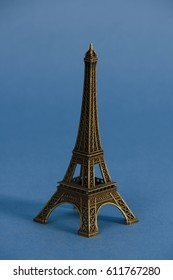 Eiffel tower from Paris in studio against blue background