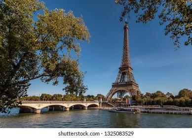 Eiffel Tower in Paris in tourist season
