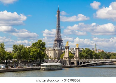 The Eiffel Tower and Pont Alexandre III at night in Paris, France