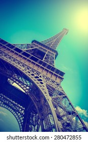 Eiffel Tower reflected in water. Summer in Paris. Travel background with retro vintage instagram filter