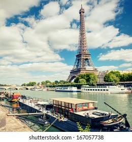 Eiffel tower at the river Seine, Paris, France. Scenic view of Paris in summer. Seine in Paris in the sunlight.