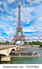 The Eiffel Tower and the river Seine in Paris on a beautiful summer day