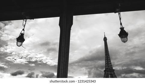 Eiffel tower seen through frame of  Bir-Hakeim bridge. Paris, France. Black and white photo.