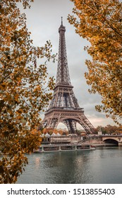 Eiffel Tower and the Seine surrounded with Autumn leaves on a Fall day